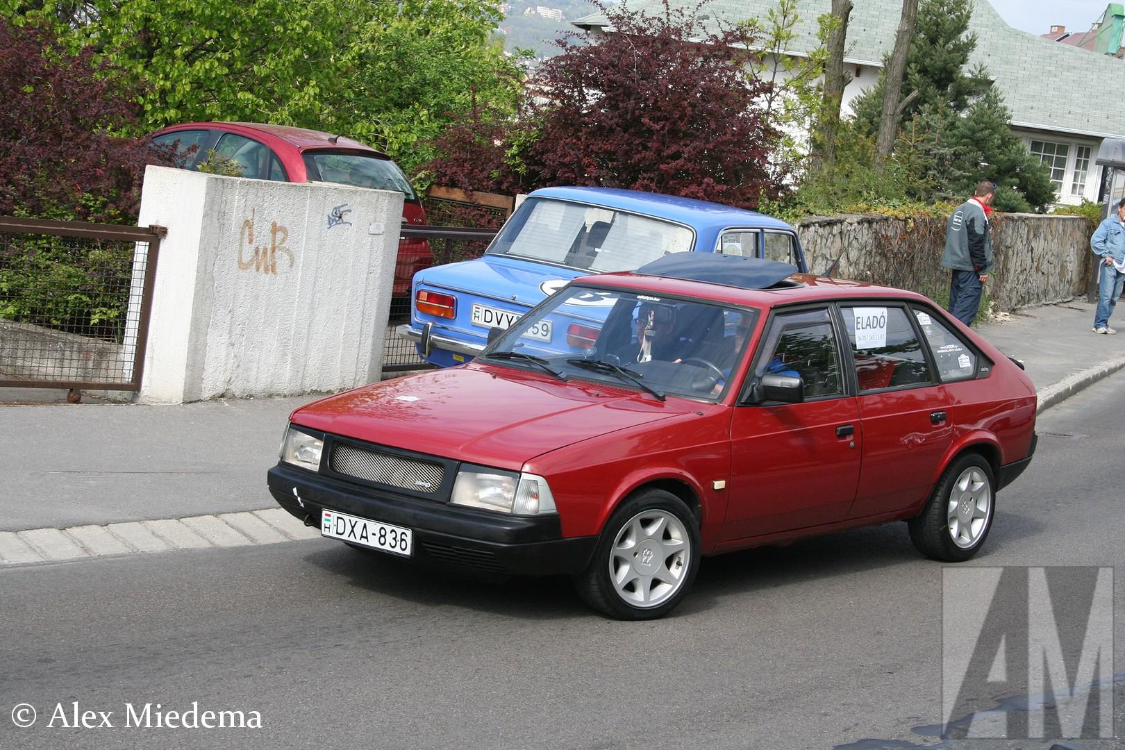 Aleko 2141S In april 2011 deed ik mee aan een rondrit voor oldtimers door Budapest. Aan die tocht nam ook een vrij bijzondere auto deel, een Aleko 2141S. De Aleko was een type van Moskvich, maar werd in sommige landen als apart merkgevoerd. Hij werd in 1985 aan het publiek voorgesteld, een jaar later kam hij op de markt. De laatste Aleko rolde in 2003 van de band. Aleko 2141S In april 2011 deed ik mee aan een rondrit voor oldtimers door Budapest. Aan die tocht nam ook een vrij bijzondere auto deel, een Aleko 2141S. De Aleko was een type van Moskvich, maar werd in sommige landen als apart merkgevoerd. Hij werd in 1985 aan het publiek voorgesteld, een jaar later kam hij op de markt. De laatste Aleko rolde in 2003 van de band. Aleko 2141S In april 2011 deed ik mee aan een rondrit voor oldtimers door Budapest. Aan die tocht nam ook een vrij bijzondere auto deel, een Aleko 2141S. De Aleko was een type van Moskvich, maar werd in sommige landen als apart merkgevoerd. Hij werd in 1985 aan het publiek voorgesteld, een jaar later kam hij op de markt. De laatste Aleko rolde in 2003 van de band. Aleko 2141S In april 2011 deed ik mee aan een rondrit voor oldtimers door Budapest. Aan die tocht nam ook een vrij bijzondere auto deel, een Aleko 2141S. De Aleko was een type van Moskvich, maar werd in sommige landen als apart merkgevoerd. Hij werd in 1985 aan het publiek voorgesteld, een jaar later kam hij op de markt. De laatste Aleko rolde in 2003 van de band. Aleko 2141S In april 2011 deed ik mee aan een rondrit voor oldtimers door Budapest. Aan die tocht nam ook een vrij bijzondere auto deel, een Aleko 2141S. De Aleko was een type van Moskvich, maar werd in sommige landen als apart merkgevoerd. Hij werd in 1985 aan het publiek voorgesteld, een jaar later kam hij op de markt. De laatste Aleko rolde in 2003 van de band. Aleko 2141S In april 2011 deed ik mee aan een rondrit voor oldtimers door Budapest. Aan die tocht nam ook een vrij bijzondere auto deel, een Aleko 2141S. De Aleko wa